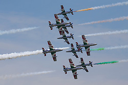 © Licensed to London News Pictures. 12/07/2014. RAF Fairford UK.The Italian Air Force Frecce Tricolori Perform at the Royal International Air Tattoo at RAF Fairford. Photo credit : Ian Schofield/LNP