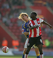 Photo: Lee Earle.<br /> Southampton v Cardiff City. Coca Cola Championship. 21/10/2007. Cardiff's Glenn Loovens (L) clashes with Bradley Wright-Phillips.