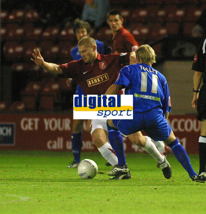 Photo: Dave Linney.<br />Walsall v Macclesfield Town. The FA Cup. 21/11/2006.<br />Walsall's Michael Dobson(L) keeps  Jamie Tolley at bay.