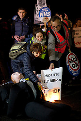 © Licensed to London News Pictures .Demonstrators join the People's Assembly national day of action and march along Westminster Bridge to protest against rising energy bills and cuts in the NHS. (05/11/2013) . Photo credit : Isabel Infantes /LNP