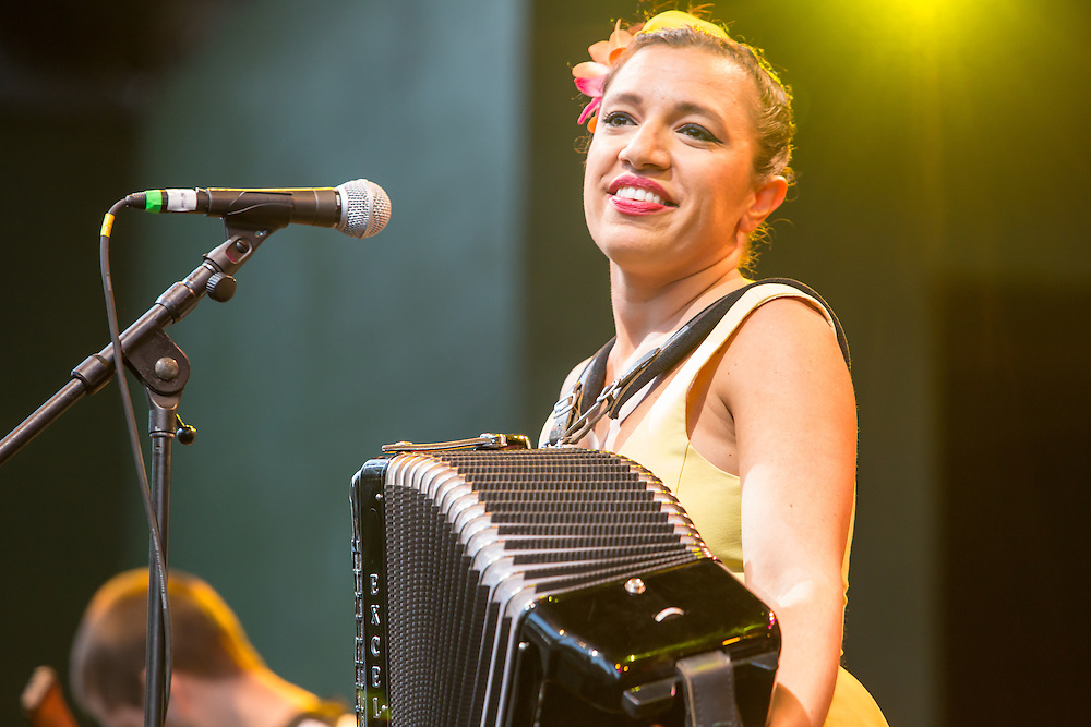 Magda Giannikou playing her accordion on stage  at Celebrate Brooklyn!