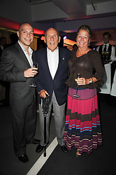 SIR STIRLING & LADY MOSS and their son ELLIOT MOSS at a party to celebrate 150 years of TAG Heuer held at the car park at Selfridge's, London on 15th September 2010.