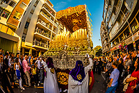 A paso (float) of the Virgin Mary in the procession of the Brotherhood (Hermandad) San Benito, Holy Week (Semana Santa), Seville, Andalusia, Spain.