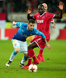 Mathieu Debuchy of Arsenal goes past Sehrou Guirassy of Cologne - Mandatory by-line: Robbie Stephenson/JMP - 23/11/2017 - FOOTBALL - RheinEnergieSTADION - Cologne,  - Cologne v Arsenal - UEFA Europa League Group H