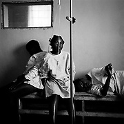 """Back in Goma, Feza Maniriho, 20, center, along with two other victims, awaits her turn to receive a fistula repair surgery at Keshero Hospital. On that day, a special doctor for fistula surgery from South Kivu was invited and performed four operations. She said she was raped by two armed men who spoke """"Lingala,"""" the language of the government soldiers."""