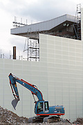 A mechanical digger takes part in the demolition of the  National Stadium, Shinjuku, Tokyo, Japan. Friday March 6th 2015. Large scale demolition work officially began, March 5th to remove  the old stadium, which was the venue for the 1964 Olympics, after many delays. Construction of the new Olympic stadium for the 2020 games is scheduled to begin in October 2015