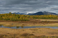 View over autumn mountain landscape from Kungsleden trail to distant mountains of Sarek national park, Lapland, Sweden