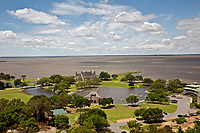 NC01363-00...NORTH CAROLINA - View southwest over the historic boathouse and Whalehead Club on the shores of Currituck Sound from the Observation Deck of the Currituck Beach Lighthouse on the Outer Banks at Corrola.