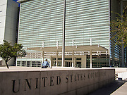 01 OCTOBER 2013 - PHOENIX, AZ: A man walks into the US Courthouse in Phoenix Tuesday. Scheduled trials continued in the building Tuesday but many offices were closed on the first day of the US government shutdown. The US government closed most non-essential federal services Tuesday. The shutdown is be the first in the US in 17 years. More than 700,000 federal government workers could be sent home on unpaid leave, with no guarantee of back pay once the deadlock is over.    PHOTO BY JACK KURTZ