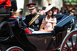© Licensed to London News Pictures. 09/06/2018. London, UK. The DUKE OF SUSSEX and MEGHAN DUCHESS OF SUSSEX rides in a carriage to attend the Trooping The Colour ceremony in London. This years event is part of a weekend of celebration to mark the 92th birthday of Queen Elizabeth II, who is Britain's longest reigning monarch.Photo credit: Ray Tang/LNP