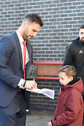 Nottingham Forest forward Apostolos Vellios (39) signs an autograph for a young Forest supporter during the The FA Cup 3rd round match between Nottingham Forest and Arsenal at the City Ground, Nottingham, England on 7 January 2018. Photo by Jon Hobley.