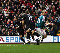 Photo: Mark Stephenson/Sportsbeat Images.<br /> Liverpool v Manchester United. The FA Barclays Premiership. 16/12/2007.Carlos Tevez celebrates his goal while a dejacted Jose Reina looks on