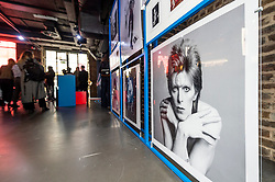 © Licensed to London News Pictures. 25/10/2021. LONDON, UK.  Posters on sale at the opening of a David Bowie pop-up shop in Heddon Street in the West End.  Open 75 days before the late singer's 75th birthday, the pop-up is located close to where Bowie posed as Ziggy Stardust on the cover of his 1972 album The Rise and Fall of Ziggy Stardust and the Spider from Mars.  The store sells limited edition records and memorabilia curated by his estate and will be open until January 2022. A sister shop will open in New York and both form part of a year long celebration of David Bowie's 75th birthday.  Photo credit: Stephen Chung/LNP