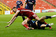 Aberdeen forward Ryan Edmondson (32) is tackled during the Scottish Premiership match between Aberdeen and Hamilton Academical FC at Pittodrie Stadium, Aberdeen, Scotland on 20 October 2020.