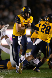 California quarterback Chase Garbers (7) hands off to running back Damien Moore (28) during the fourth quarter of an NCAA college football game against Nevada, Saturday, Sept. 4, 2021, in Berkeley, Calif. (AP Photo/D. Ross Cameron)