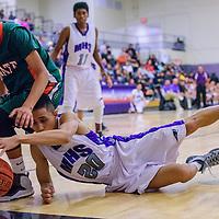 011715       Cable Hoover<br /> <br /> Miyamura Patriot David Gustilo (20) dives in to grab the ball away from Wingate Bear Brandon Belone (5) Saturday at Miyamura High School.