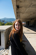 A young Australian woman backpacking in Europe sits in the abandoned Ljubljanska Banka Tower in Mostar, Bosnia and Herzegovina. The building was used as a sniper tower by Croat forces during the Bosnian war and siege of Mostar in the early 1990s and has been abandoned ever since.