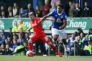 Alberto Moreno of Liverpool looks to get away from Tyias Browning of Everton. Barclays Premier League match, Everton v Liverpool at Goodison Park in Liverpool on Sunday 4th October 2015.<br /> pic by Chris Stading, Andrew Orchard sports photography.