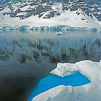 An iceberg floats in the Peltier Channel below the Fief Range on Wiencke Island, Antarctica.