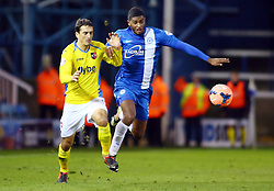 Peterborough United's Mark Little in action with Exter City's Craig Woodman - Photo mandatory by-line: Joe Dent/JMP - Tel: Mobile: 07966 386802 09/11/2013 - SPORT - FOOTBALL - London Road Stadium - Peterborough - Peterborough United v Exeter City - FA Cup - First Round