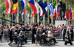 File photo dated 10/05/15 showing veterans passing the statue of Sir Winston Churchill, during the VE Day Parade to mark the 70th anniversary of VE Day, at Parliament Square in London, celebrating VE (Victory in Europe) Day in London, marking the end of the Second World War in Europe now 75 years ago.
