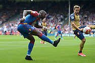 Yannick Bolasie of Crystal Palace crosses the ball. Barclays Premier league match, Crystal Palace v Arsenal at  Selhurst Park in London on Sunday 16th August 2015.<br /> pic by John Patrick Fletcher, Andrew Orchard sports photography.