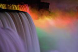 American and Bridal Veil falls illuminated at night.