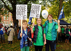 © Licensed to London News Pictures. 17/10/2013.  Bristol, UK.  Picture l-r: Callum Tooby age 11, Georgia Tooby age 13, and their mother Tanya Tooby who is a nursery teacher.  Teachers go on a one day strike in the south west of England in a series of strikes across the UK against plans by Government Minister Michael Gove to change teachers' pay, hours and pensions.  The strike was organised by the NUT and NASUWT trade unions, and teachers marched through the centre of Bristol to hold rallies. 17 October 2013.<br /> Photo credit : Simon Chapman/LNP