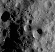 This Dawn framing camera (FC) image of steroid Vesta shows Fabia crater, which is the large crater offset to the bottom right of the center of the image. Fabia crater is very distinctive because the two sides of its rim have very different states of freshness. In this image the bottom part of the rim is distinct and fresh but the top part of the rim is much more rounded and degraded. This image is located in Vesta's Numisia quadrangle, in Vesta's northern hemisphere. NASA's Dawn spacecraft obtained this image with its framing camera on Oct. 19, 2011.
