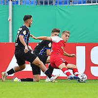 13.09.2020, Carl-Benz-Stadion, Mannheim, GER, DFB-Pokal, 1. Runde, SV Waldhof Mannheim vs. SC Freiburg, <br /> <br /> DFL REGULATIONS PROHIBIT ANY USE OF PHOTOGRAPHS AS IMAGE SEQUENCES AND/OR QUASI-VIDEO.<br /> <br /> im Bild: Nils Petersen (#18, SC Freiburg) gegen Onur Uenluefcifci (SV Waldhof Mannheim #7) und Jan Just (SV Waldhof Mannheim #22)<br /> <br /> Foto © nordphoto / Fabisch