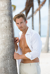 good looking man in an open shirt at the beach in Florida