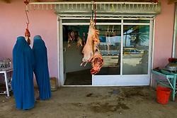 Women shop at a butcher shop in Kabul, Afghanistan. (Photo © Jock Fistick)
