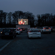 Dozens of cars attending the screening are instructed to carefully line up at 1.5 meters apart, as messages displaying guidelines for social distancing measures aimed at minimising the spread of Covid-19 are shown on the screen. Dublin, Ireland - March 23, 2020.