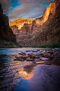 """Reflection in the Colorado River at Lava Falls, in the Grand Canyon National Park<br /> .....<br /> The Grand Canyon is a steep-sided canyon carved by the Colorado River in the state of Arizona in the United States. It is contained within and managed by Grand Canyon National Park, the Hualapai Tribal Nation, the Havasupai Tribe and the Navajo Nation. President Theodore Roosevelt was a major proponent of preservation of the Grand Canyon area, and visited it on numerous occasions to hunt and enjoy the scenery.<br /> The Grand Canyon is 277 miles long, up to 18 miles wide and attains a depth of over a mile. Nearly two billion years of Earth's geological history have been exposed as the Colorado River and its tributaries cut their channels through layer after layer of rock while the Colorado Plateau was uplifted. While the specific geologic processes and timing that formed the Grand Canyon are the subject of debate by geologists, recent evidence suggests that the Colorado River established its course through the canyon at least 17 million years ago. Since that time, the Colorado River continued to erode and form the canyon to its present-day configuration.<br /> For thousands of years, the area has been continuously inhabited by Native Americans who built settlements within the canyon and its many caves. The Pueblo people considered the Grand Canyon (""""Ongtupqa"""" in the Hopi language) a holy site, and made pilgrimages to it. The first European known to have viewed the Grand Canyon was García López de Cárdenas from Spain, who arrived in 1540."""