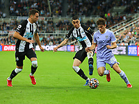 NEWCASTLE UPON TYNE, ENGLAND - SEPTEMBER 17: Daniel James of Leeds United is pressured by Javier Manquillo of Newcastle United and Miguel Almiron of Newcastle United during the Premier League match between Newcastle United and Leeds United at St. James Park on September 17, 2021 in Newcastle upon Tyne, England. (Photo by MB Media)