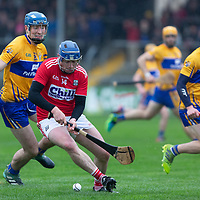 Cork's Jamie Coughlan in action against Clare's David Fitzgerald