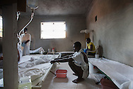 Pauleis Senti  gets out of bed in case he will need to vomit at the Real Hope for Haiti  Cholera Clinic in Cazel. The clinic is 11 kilometers off the main road passing through Cabaret, north of Port-au-Prince is run by missionaries.