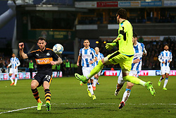 Danny Ward of Huddersfield Town makes a clearance under pressure from Daryl Murphy of Newcastle United - Mandatory by-line: Matt McNulty/JMP - 04/03/2017 - FOOTBALL - The John Smith's Stadium - Huddersfield, England - Huddersfield Town v Newcastle United - Sky Bet Championship