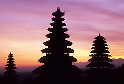 Asia, Indonesia, Bali, Pura (Temple) Besakih, meru pagodas with thatched roofs at sunset