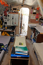 06 April 2011. St Maarten, Antilles, Caribbean.<br /> Crew of the Antiki raft arrive in the islands following their epic 9 week trans-Atlantic journey from the Canary islands.  Conditions aboard the very cramped 'Antiki'. The toilet ('room with a view'), shower, emergency raft on the raft! And the cramped living quarters, bunks, radio and satellite equipment, books, cooking facilities, and personal effects.<br /> Crew; Anthony Smith (84 yrs old) British adventurer, John Russell, solicitor and UK resident, David Hildred, sailing master and British Virgin Islands resident,  Dr Andrew Bainbridge of Alberta, Canada.<br /> Photo; Charlie Varley/varleypix.com