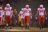 Jared Crick (94), Ndamukong Suh (93) and Pierre Allen (95) walk to the line of scrimmage in the rain during Nebraska's 27-12 win in Columbia, Mo. on Oct. 8, 2009.  © Aaron Babcock
