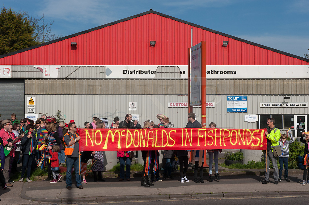 "© Licensed to London News Pictures. 25/03/2017. Bristol, UK. A ""musical parade"" protest by the ""Say No to McDonalds in Fishponds"" group, part of a two-year campaign against the fast-food chain's proposed new drive-through McDonalds on Fishponds Road. Plans for a two-storey burger bar in Fishponds, which would be built on the site of The Old Tile Factory, were refused by Bristol City Council in February 2015 amid congestion fears and the site's close proximity to a school. A public appeal by McDonalds was meant to be heard in November 2016 but had to be adjourned after McDonald's' barrister was ""not available"". The appeal has bee re-scheduled until 20 April 2017, and is expected to last six days.  Photo credit : Simon Chapman/LNP"