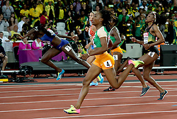 USA's Tori Bowie (left) stumbles after winning gold in the Women's 100m Final ahead of Ivory Coast's Marie-Josee Ta Lou (right) during day three of the 2017 IAAF World Championships at the London Stadium.