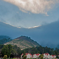 Incoming fog pours over the Golden Gate Headlands and Cavallo Point Lodge, a luxury hotel just north of San Francisco in Sausalito, California.
