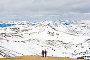 A pair of hikers descend the ridge to Grizzly Peak near Loveland Pass, Rocky Mountains, Colorado.
