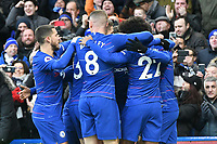 Football - 2018 / 2019 Premier League - Chelsea vs. Huddersfield Town<br /> <br /> Gonzalo Higuaín of Chelsea is mobbed  by team mates as he celebrates scoring his team's first goal, at Stamford Bridge.<br /> <br /> COLORSPORT/WINSTON BYNORTH