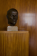 Lenin bust in preserved office of former Minister in charge of GDR secret police chief, Erich Mielke - an exhibit in 'Haus 1' the ministerial headquarters of the Stasi secret police in Communist East Germany, the GDR. Built in 1960, the complex now known as the Stasi Museum. Before the fall of the Wall, it was a 22-hectare complex of espionage whose centrepiece is the office and working quarters of the former Minister of State Security, Mielke who considered their role as the 'shield and sword of the party', conducting one of the world's most efficient spying operations against its political dissenters during its 40-year old socialist history. After the fall of the socialist state, Mielke was sentenced to 6 years in prison and died in 2000, aged 92. During Hitler's Third Reich, the Gestapo had one agent for every 2,000 citizens whereas the Stasi had approximately an spy for every 6.5. Here at the Stasi HQ alone 15,000 were employed plus the many regional stations. German media called East Germany 'the most perfected surveillance state of all time' - administered from this complex of offices.