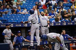 July 21, 2017 - St. Petersburg, Florida, U.S. - WILL VRAGOVIC   |   Times.Texas Rangers shortstop Elvis Andrus (1) greeted at the dugout by second baseman Rougned Odor (12) after his solo home run in the first inning of the game between the Texas Rangers and the Tampa Bay Rays at Tropicana Field in St. Petersburg, Fla. on Friday, July 21, 2017. (Credit Image: © Will Vragovic/Tampa Bay Times via ZUMA Wire)