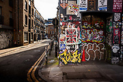 Graffiti and flyposting closed Petticoat Lane building during the coronavirus pandemic on the 2nd May 2020 in London, United Kingdom.