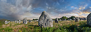 View of Carnac neolthic standing stones monaliths, a pre-Celtic site of standing stomes used from 4500 to 2000 BC,<br /> <br /> Carnac is famous as the site of more than 10,000 Neolithic standing stones, also known as menhirs. The stones were hewn from local rock and erected by the pre-Celtic people of Brittany. The Carnac stones were erected during the Neolithic period which lasted from around 4500 BC until 2000 BC. One interpretation of the site is that successive generations visited the site to erect a stone in honour of their ancestors. '<br /> <br /> Visit our PREHISTORIC PLACES PHOTO COLLECTIONS for more  photos to download or buy as prints https://funkystock.photoshelter.com/gallery-collection/Prehistoric-Neolithic-Sites-Art-Artefacts-Pictures-Photos/C0000tfxw63zrUT4